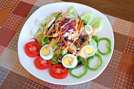 lite food: Mixed vegetable salad and egg with Thousand Island sauce.