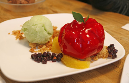 big apple: Big apple (Raspberry coated soft Cheesecake) serve with lemon ice cream