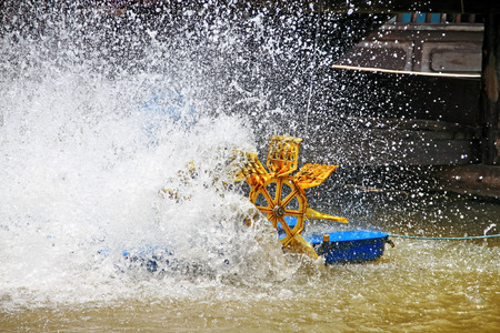 water turbine: Water turbine is working in the river Stock Photo