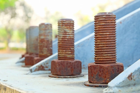 Big rusty metal nuts locked with rust and corrosion bolts photo