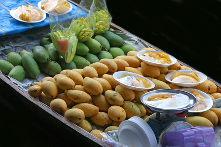 Various of tropical fruit in a boat at Floating market, Thailand photo