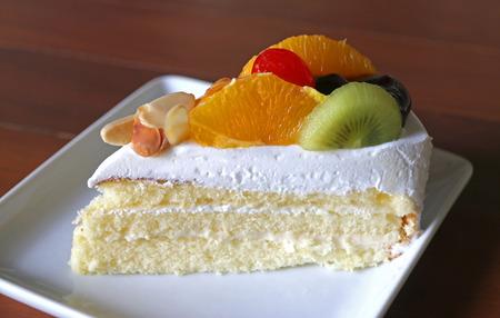 white cream: Mixed tropical fruit cake with white cream Stock Photo