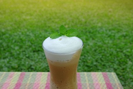 Iced coffee blend with milk foam photo