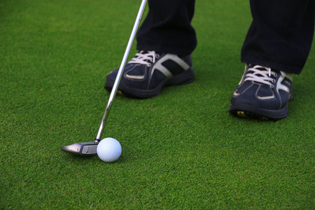 putter: Putter and ball on grass prepare to putting