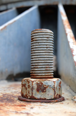 corrosion: Big rusty metal nuts locked with rust and corrosion bolts
