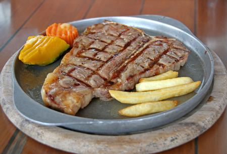 t bar: Grilled T-bone steak serve in iron hot plate