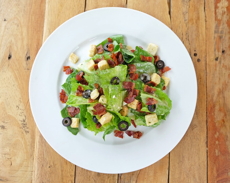 crouton: Closed up cropped caesar salad topping with crispy bacon and crouton topview