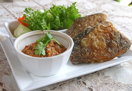pla: Deep fried dried skin Gourami Fish (Pla salit fish or Sepat siam) with shrimp chili paste sauce and vegetable set. Thailand local food