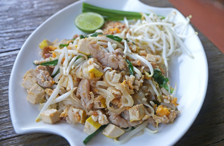Pad Thai famous Thai food, Fried noodle with pork, vegetable, tofu, egg and sweet sauce Stock Photo