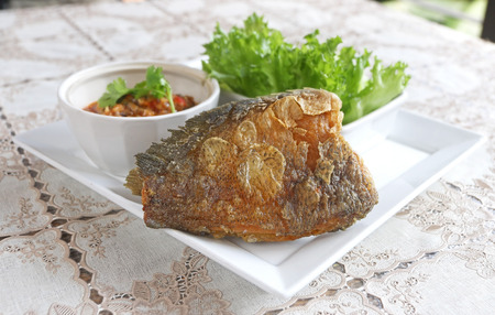 Deep fried dried skin Gourami Fish (Pla salit fish or Sepat siam) with shrimp chili paste sauce and vegetable set. Thailand local food