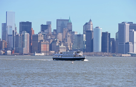 newyork: Newyork city, Newyork - MARCH 21: Transportation Ship sailing away from Downtowm Manhattan in the morning at Newyork bay, Newyork on March 21,2014.