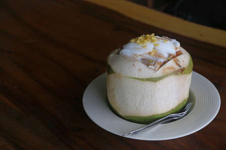 Coconut Ice Cream with nuts in coconut shell