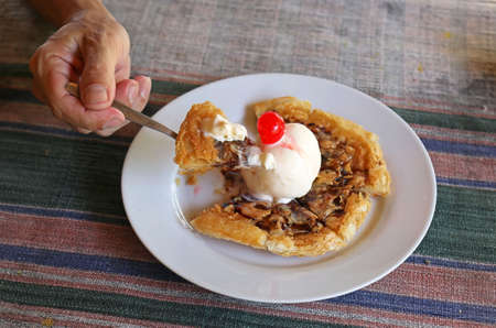 Fried crispy roti topping with vanilla ice cream and cherry