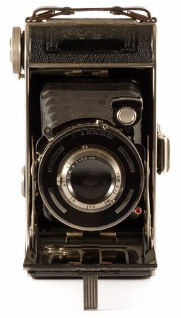 folding camera: Old folding camera from lens with white background.