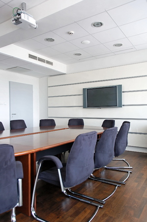 conditioned: Office empty meeting room with flat television and projector. Stock Photo