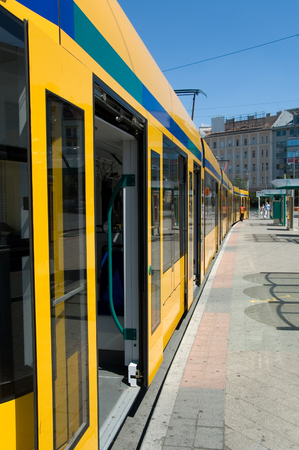 Longest articulated tram in the world exterior in Budapest (Hungary) at station. Stock Photo