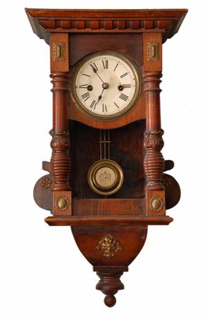 wood tick: Vintage hanging clock isolated on white background.