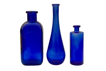 Three blue glass vases with white background. Stock Photo