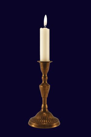 Candle-light with candelabrum isolated on dark blue. Stock Photo