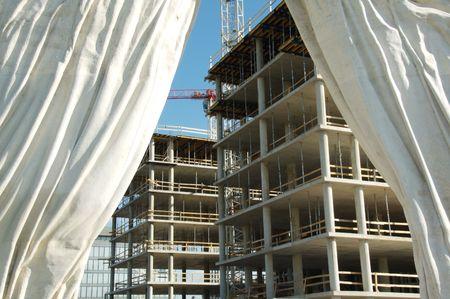 Construction behind stone curtain Stock Photo