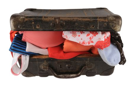 Old brown suitcase with clothes, isolated on white. Stock Photo