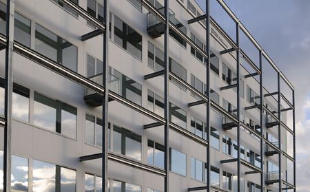 Modern office building with window and balcony, against blue sky. Stock Photo - 2546080