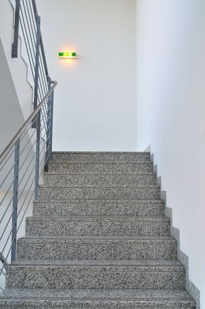 Staircase in the office with emergency light.