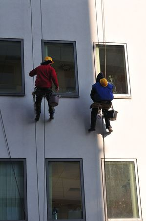 Window washers, cleaning outside on a office building. Stock Photo - 2758892