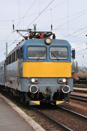 One electric locomotives at the train station, just starting. Stock Photo - 2870425
