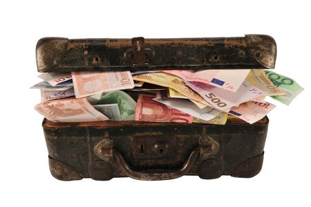 Old brown suitcase with full of different euro, isolated on white.