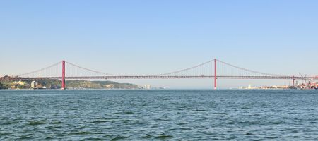 tagus: 25th April Bridge from Tagus River in Lisbon (Portugal). Stock Photo
