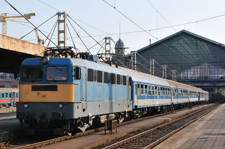 Train leaving from railway station in Budapest. Stock Photo