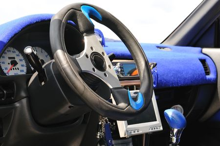 Inside the modern car with blue decoration. photo