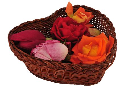 Heart shape basket with flowers isolated on white. photo
