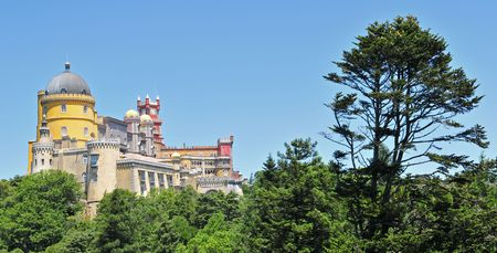 Colorful Pena palace with tree (Sintra, Lisbon area) is one of the Seven Wonders of Portugal. Stock Photo - 4365388