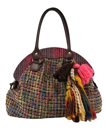 tuft: Colorful womens bag with tuft isolated on white.