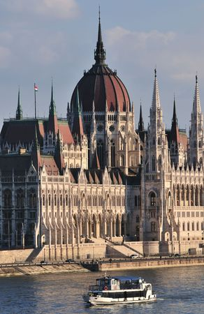 governmental: The Hungarian Parliament, an immense piece of neo-Gothic grandiloquence was build over a period of two decades (1884-1904) by the architect Imre Steindl. It is the third largest parliament building in Europe. Stock Photo