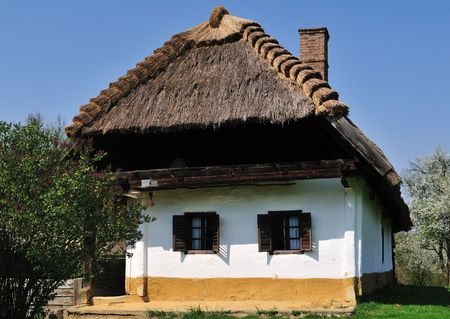 Traditional rustic house with thatched roof at Pityerszer (Hungary)