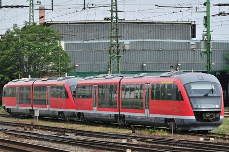 Electric red train near by the station waiting for the start in Hungary.