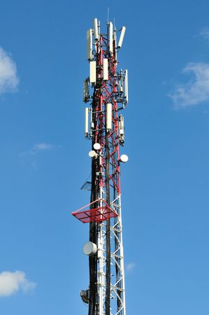microwave antenna: Big communication tower with GSM and microwave antenna.