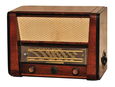 Old retro radio (first appearance in Hungary at 1956) used at home, isolated on white.