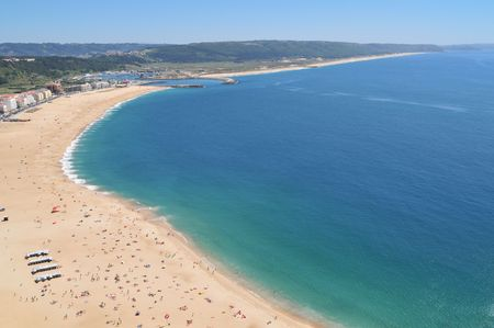 Portugal beach at Nazere in summer time from high.