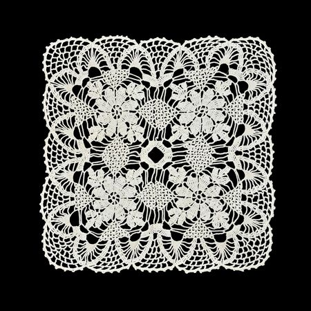 White handmade lace (square form), isolated on black.