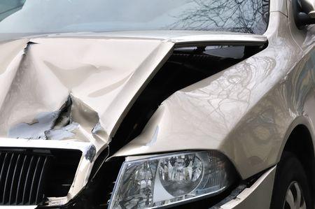 crashed: Car accident, damaged engine hood and lamp.