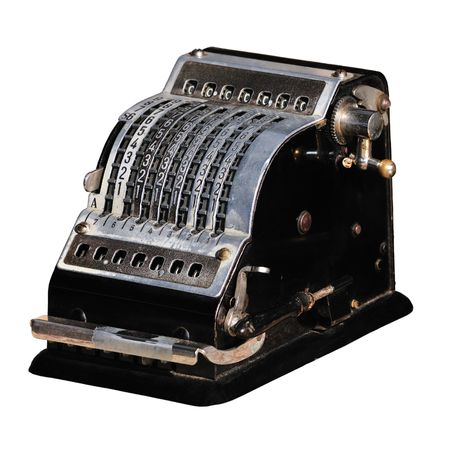 Black mechanical (vintage) calculator, isolated on white. (About 1950s - early 1970s from Germany) Stock Photo