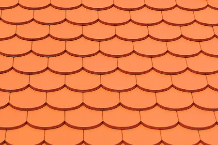 roof tiles: Detail of a house red roof tiles.