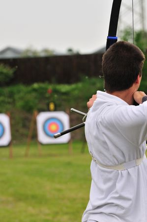 An archer takes aim at a target during competition.