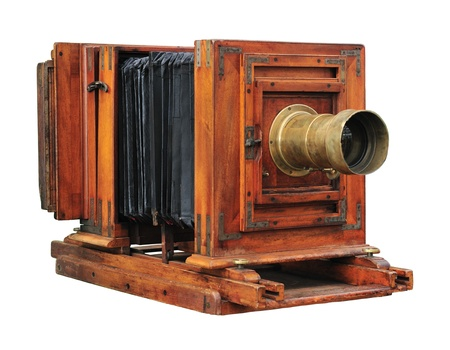 Old wooden folding camera isolated on white.