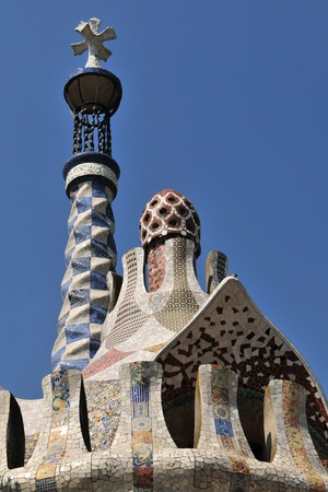 Tiled mosaic Roof of building in Gaudis Parc Guell at Barcelona (Spain). photo