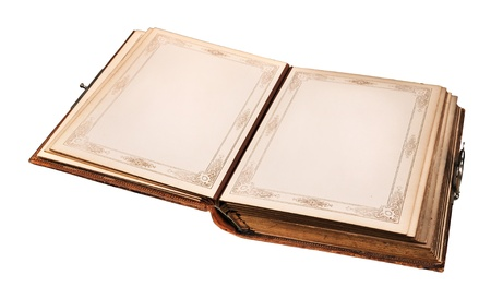 Open old book with empty pages isolated on white. (Ideal for write your own text) photo